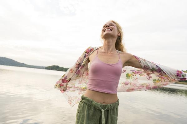 happy young woman at a lake