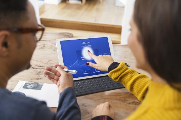 couple paying bills online using fingerprint