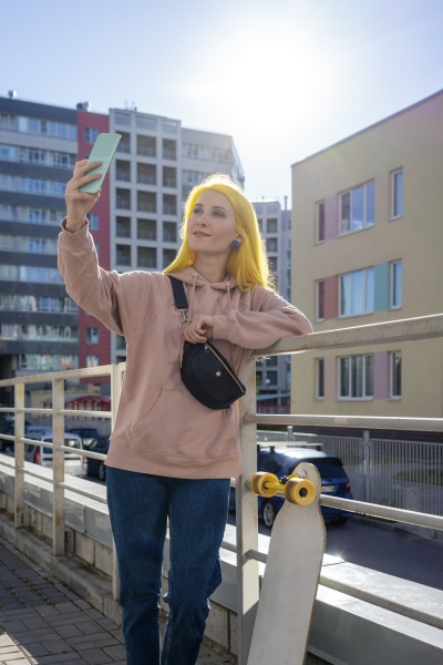young woman taking selfie on smart