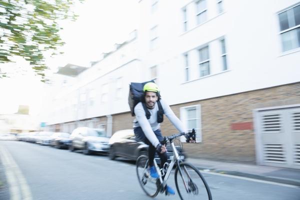 male bike messenger delivering food on