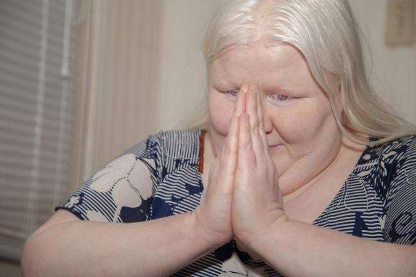 happy praying woman