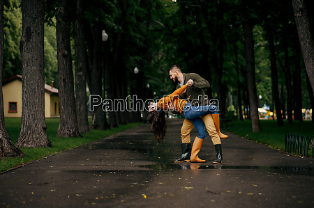 happy love couple dancing in summer